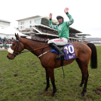 Davy Russell celebrates on Presenting Percy after winning the RSA